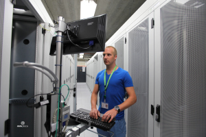 A man working on the computer in a Dutch datacenter.